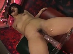 A rather huge dildo fucks her Japanese pussy