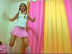 Sexy Asian Babe In Glasses And Pink Skirt ...